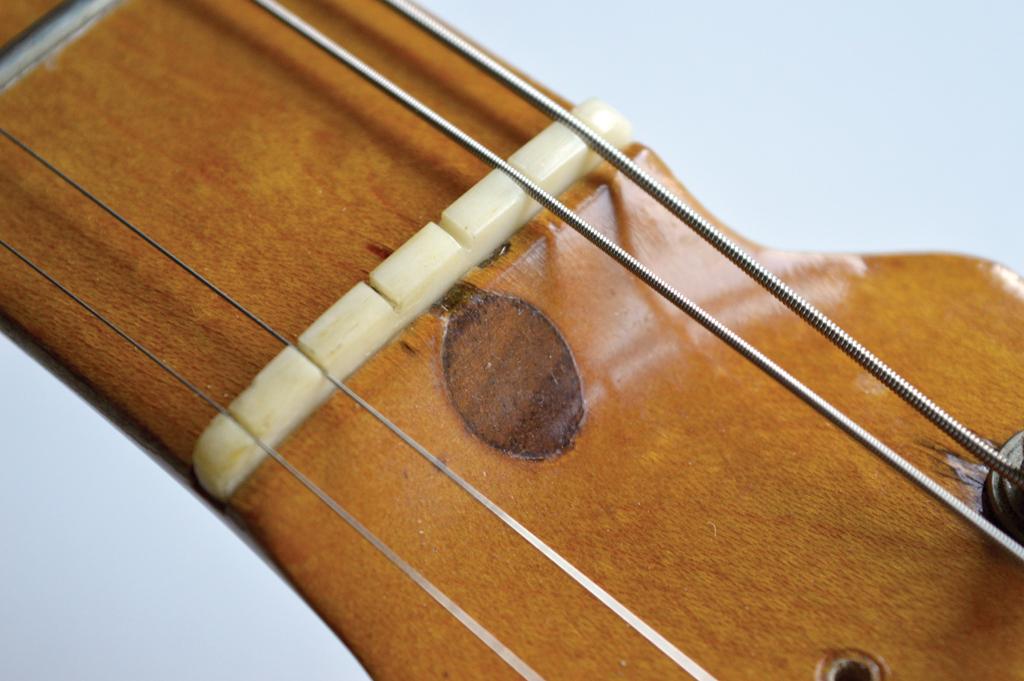 Bass guitar nut slots