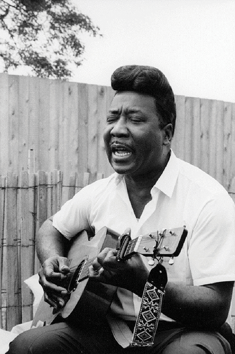 Blues legend Muddy Waters playing a 00-18E in the 1960s martin guitars