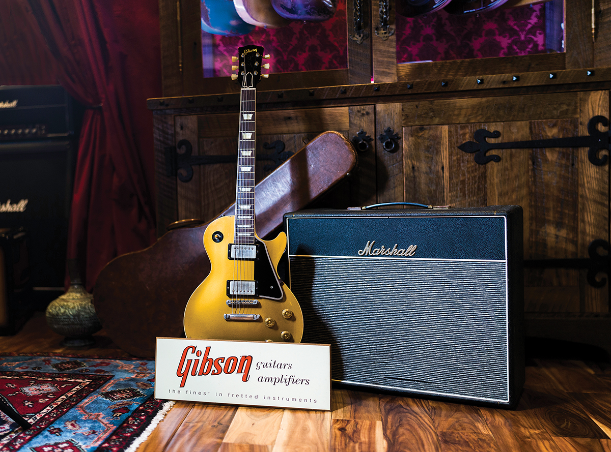Early 1957 Les Paul Goldtop (pre PAF sticker) and 1967 Marshall 18-watt 2x10 combo. 1952 Les Paul with 1950s Gibson dealer sign