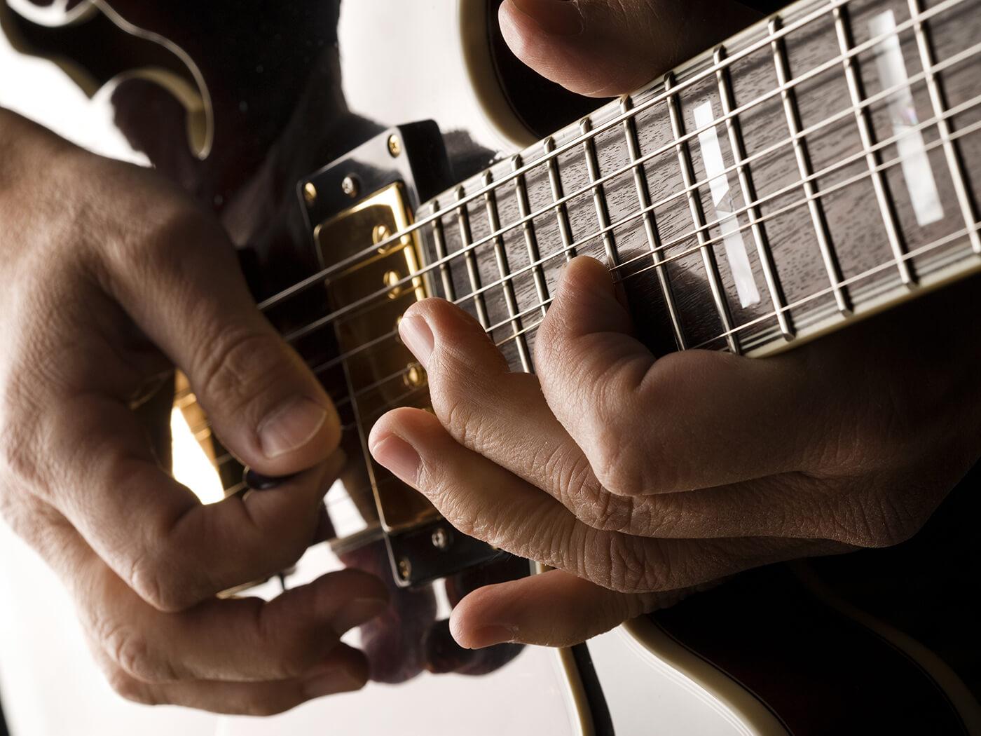 Blues guitar string bending