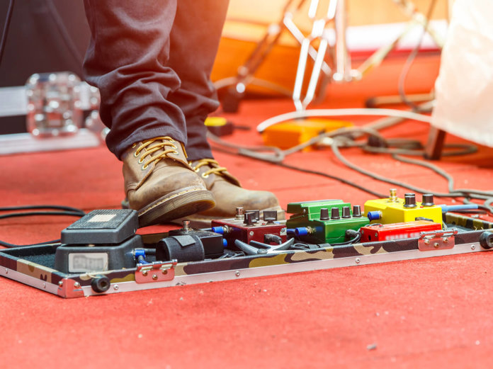 guitarist pedalboard stage
