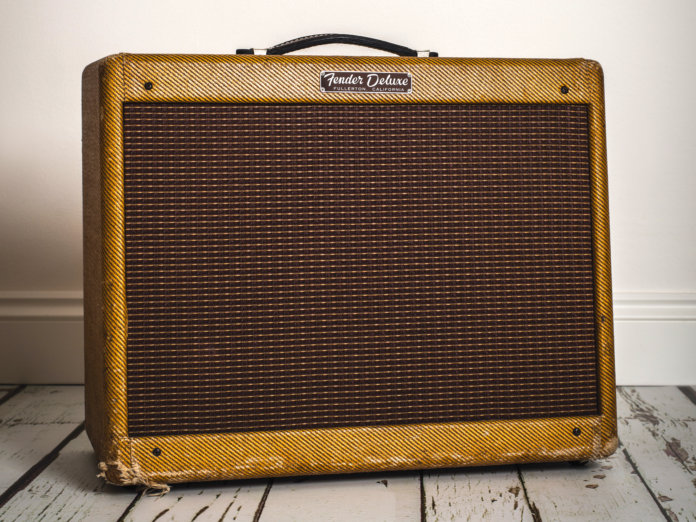 Fender tweed Deluxe amp on white floorboards