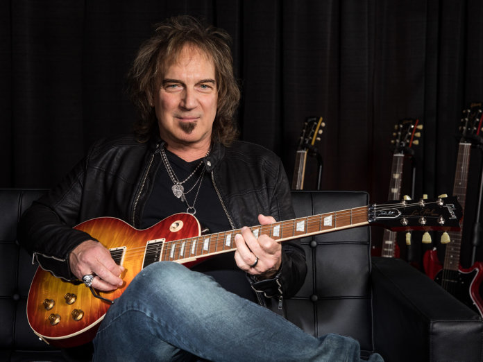 Gibson Dave Amato Les Paul Axcess Standard sat on couch
