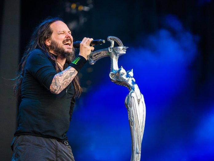 Korn's Jonathan Davis singing live shutterstock