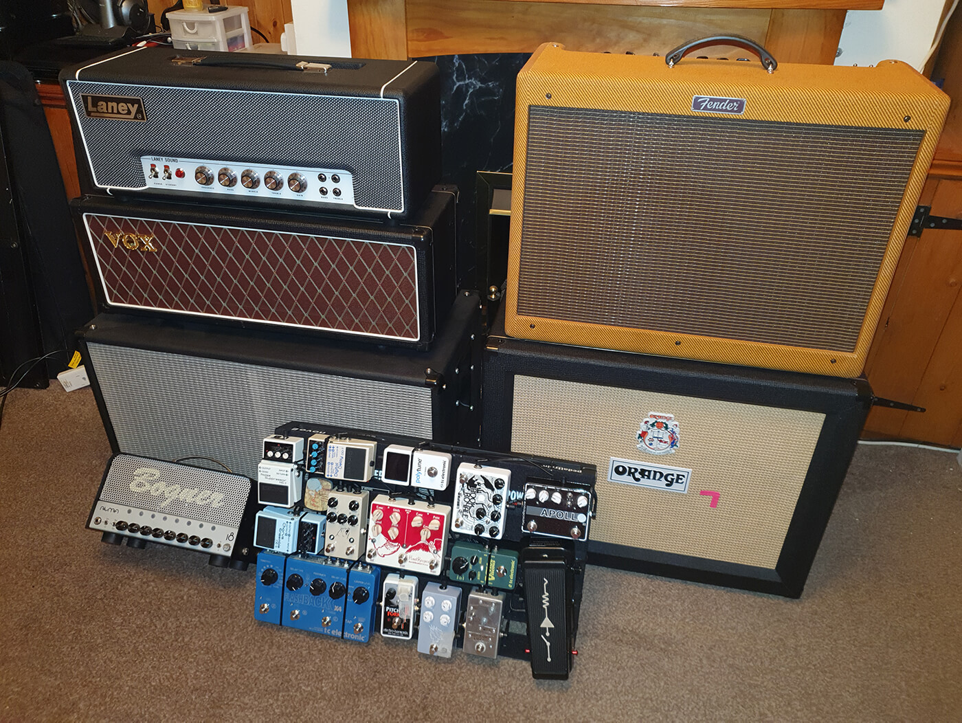 Liam Jeffery's pedalboard leaning against amps