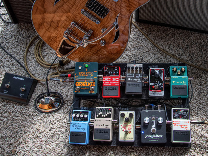 Mitchell Strauss pedalboard style shot against taylor guitar