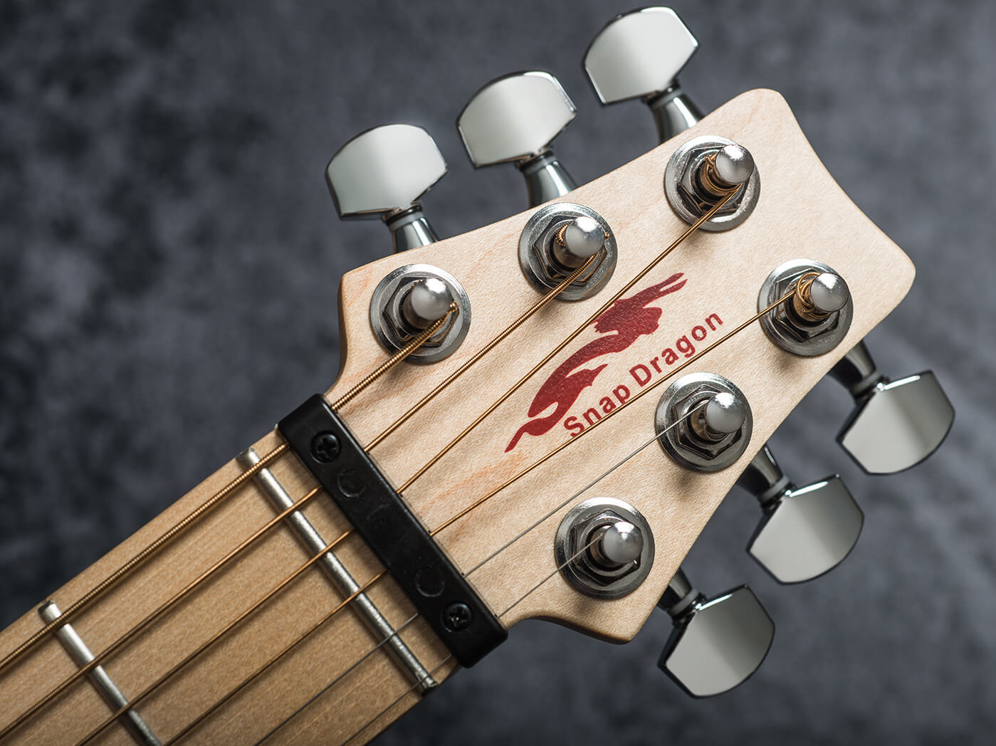 Snap Dragon travel guitars headstock