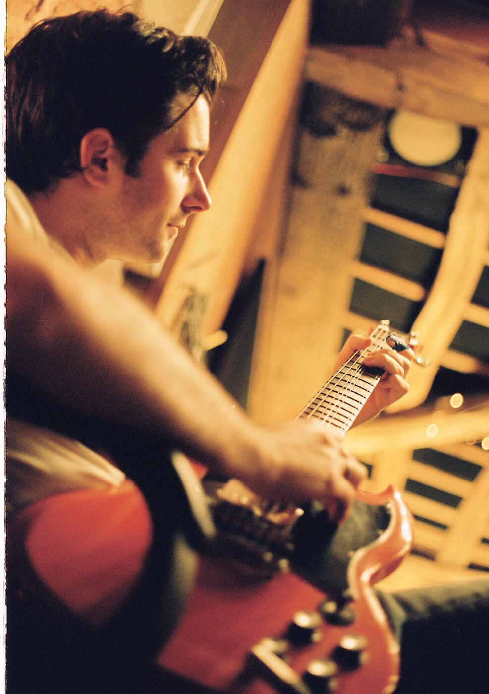 The Amazons future dust album booklet strumming guitar