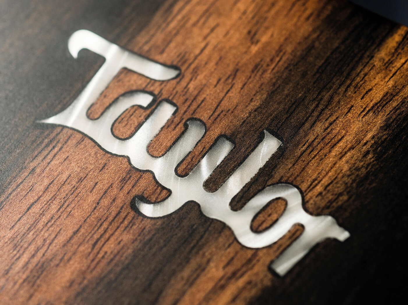 Taylor 322ce headstock engraved logo