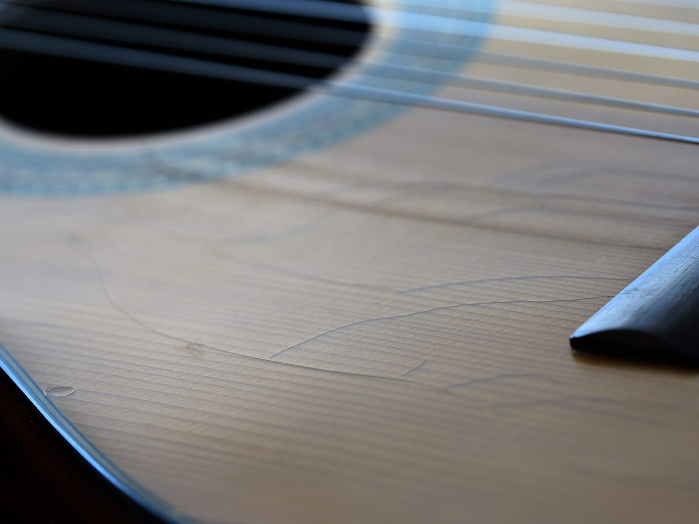 Image of cracked finish on an acoustic guitar