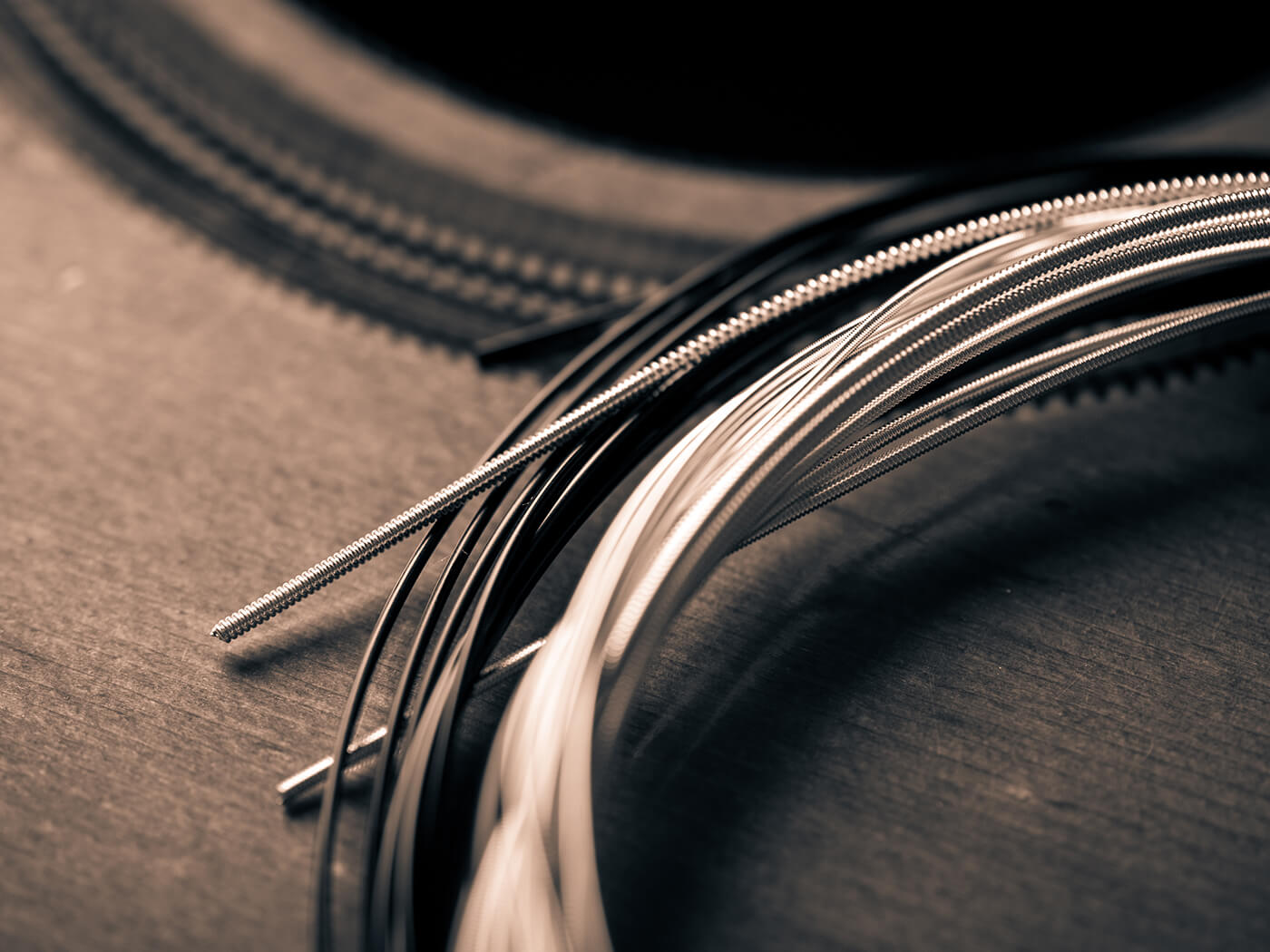 Image of strings on an acoustic guitar