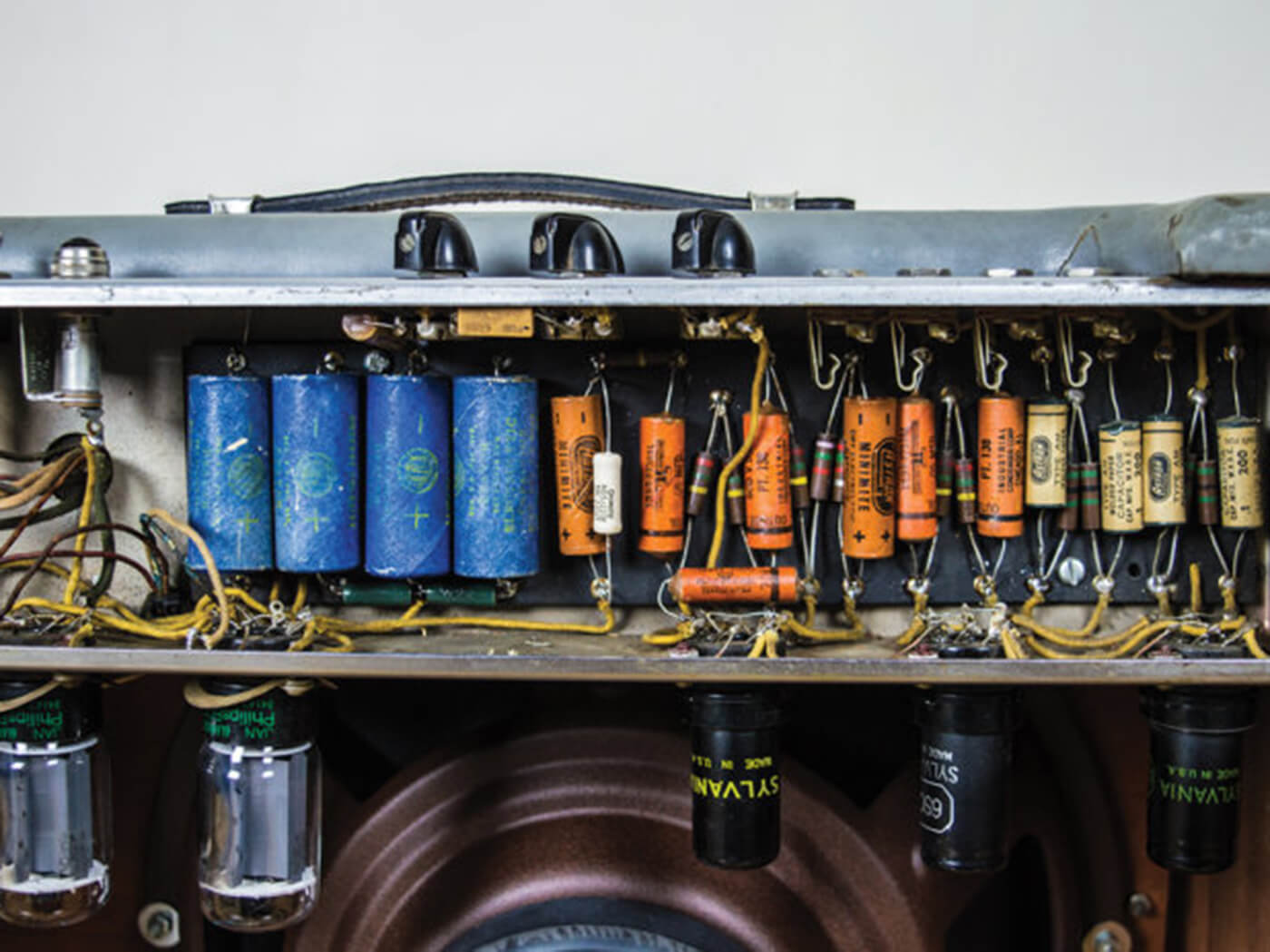 Back shot of capacitors and tubes in amp