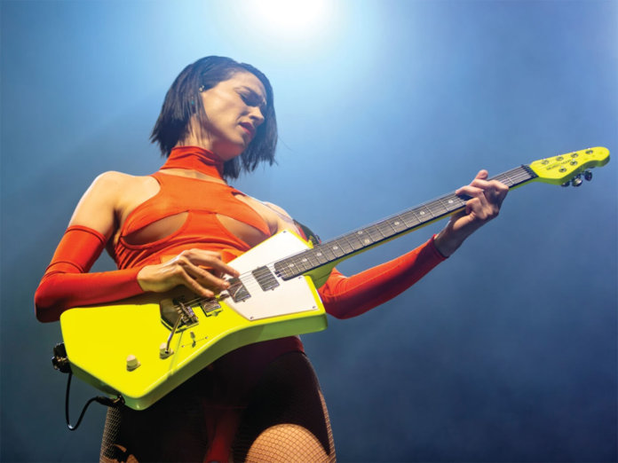 St. Vincent with yellow ernie ball signature model