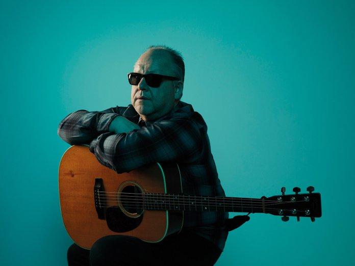 Pixies Black Francis landscape shot elbows on guitar