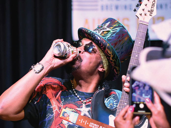 bootsy-collins drinking beer