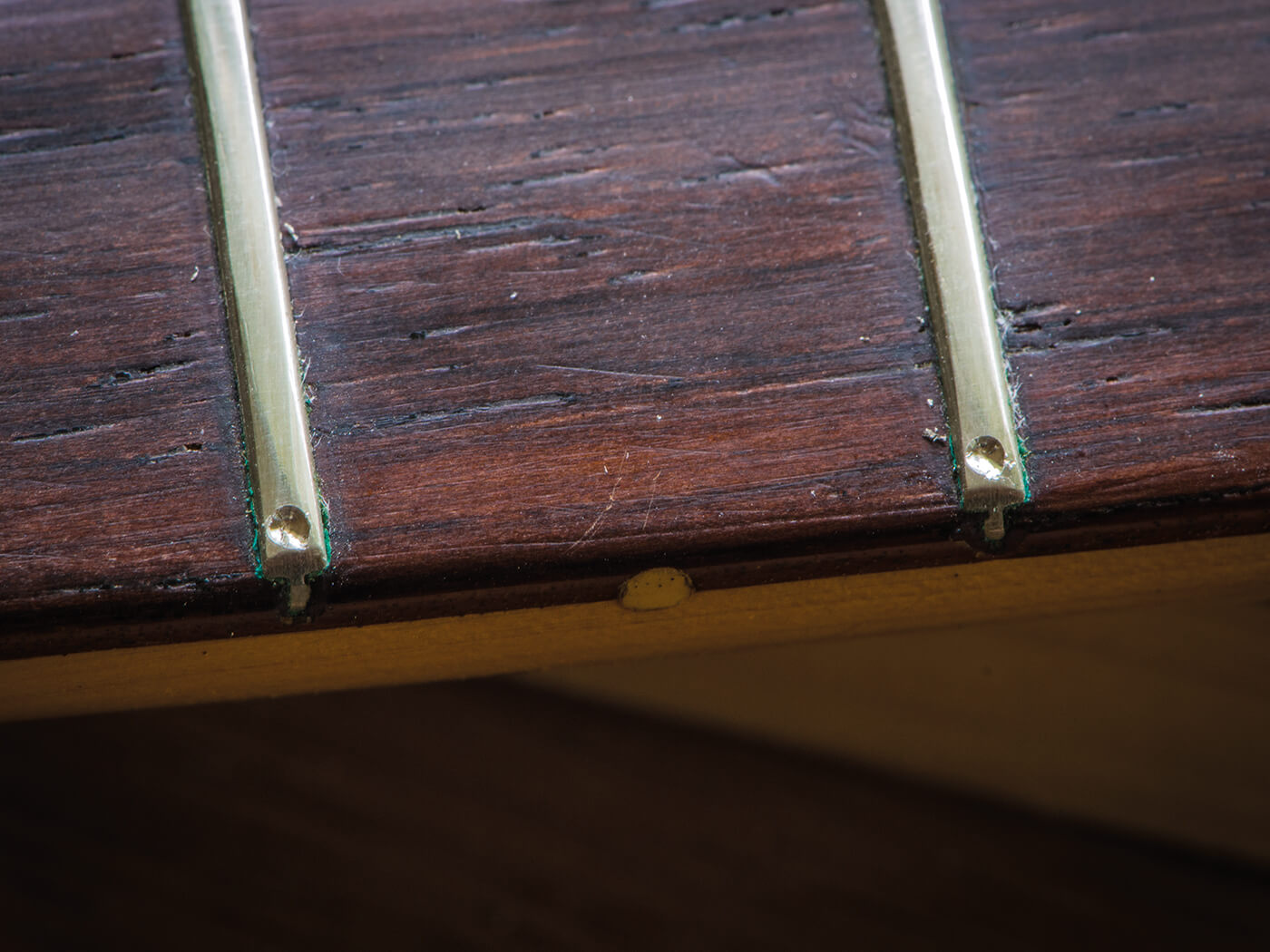 Drilled notches in frets of strat fingerboard