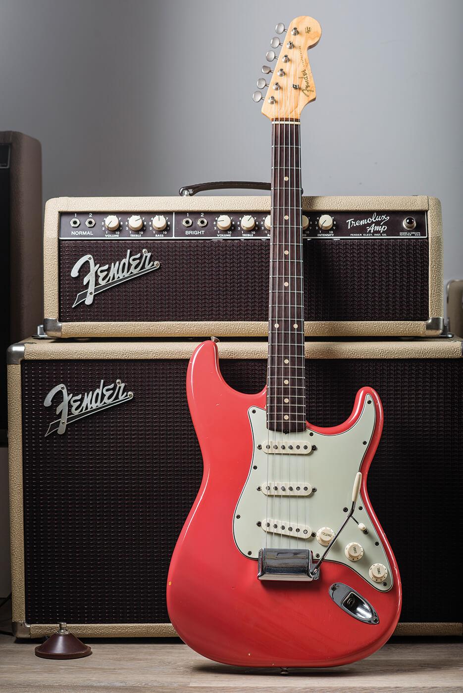 Fender Pre-CBS Fiesta Red Strat pictured besides amp