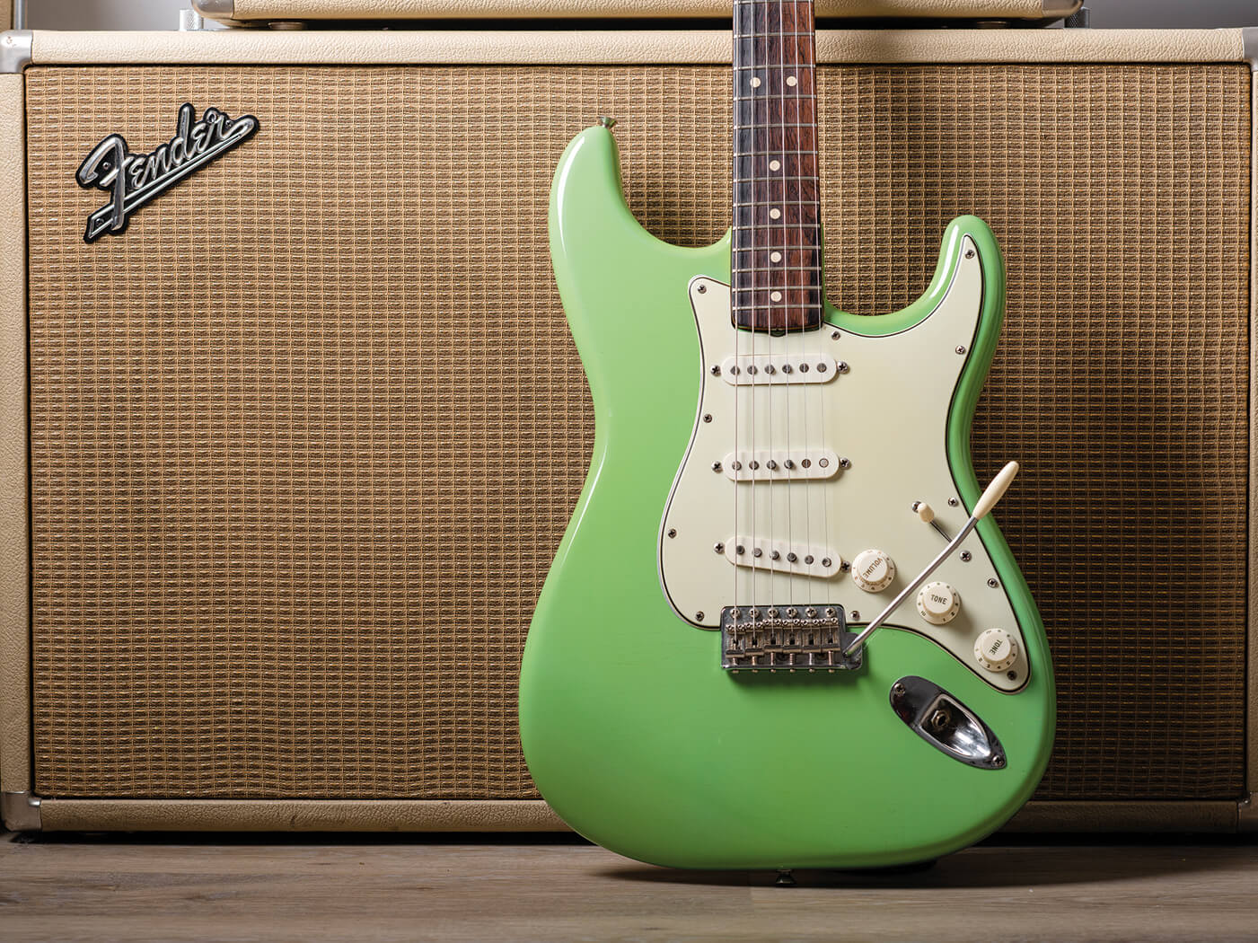 Fender Pre-CBS Surf Green Strat pictured with amp close up