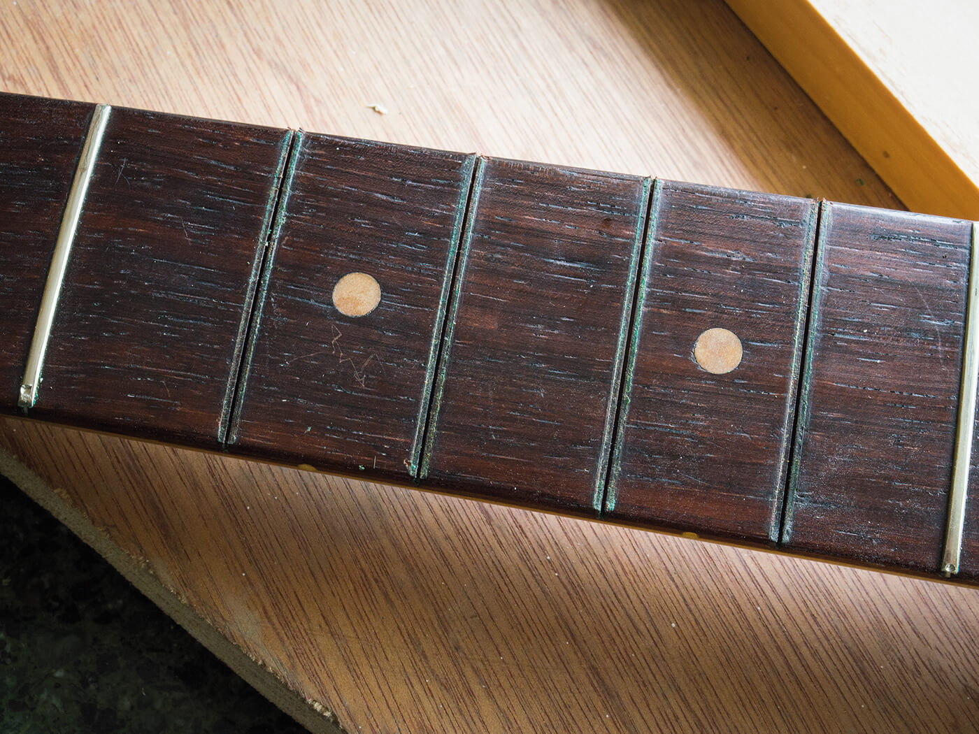 Group of removed frets on Strat fingerboard