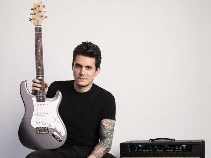 John Mayer holding PRS Silver Sky