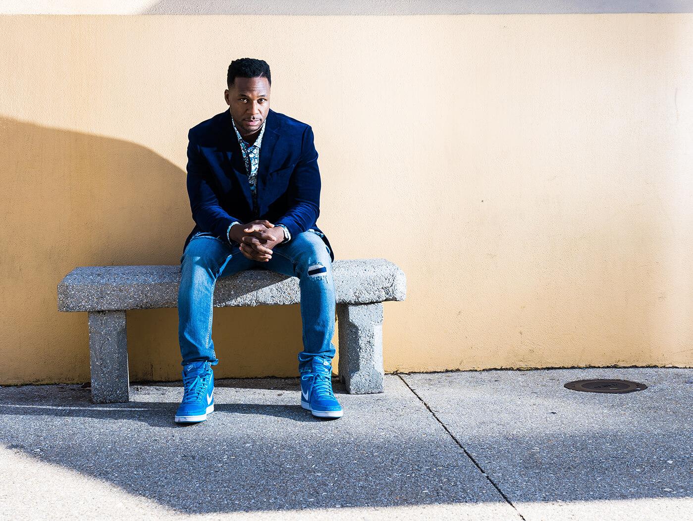 Robert Randolph sitting on bench