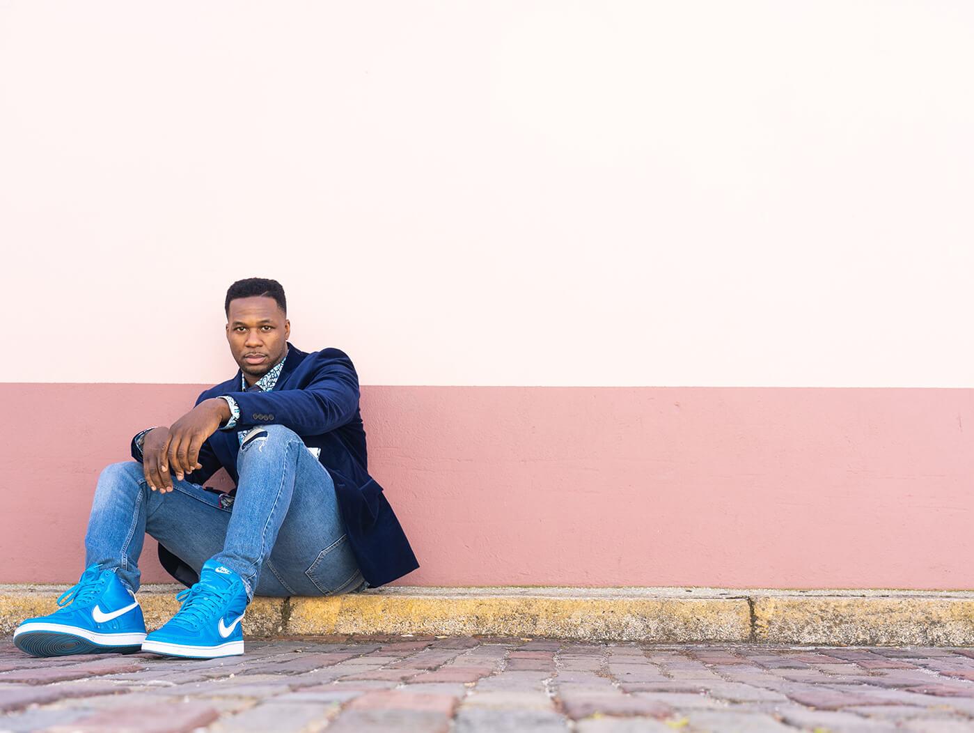 Robert Randolph sitting on sidewalk