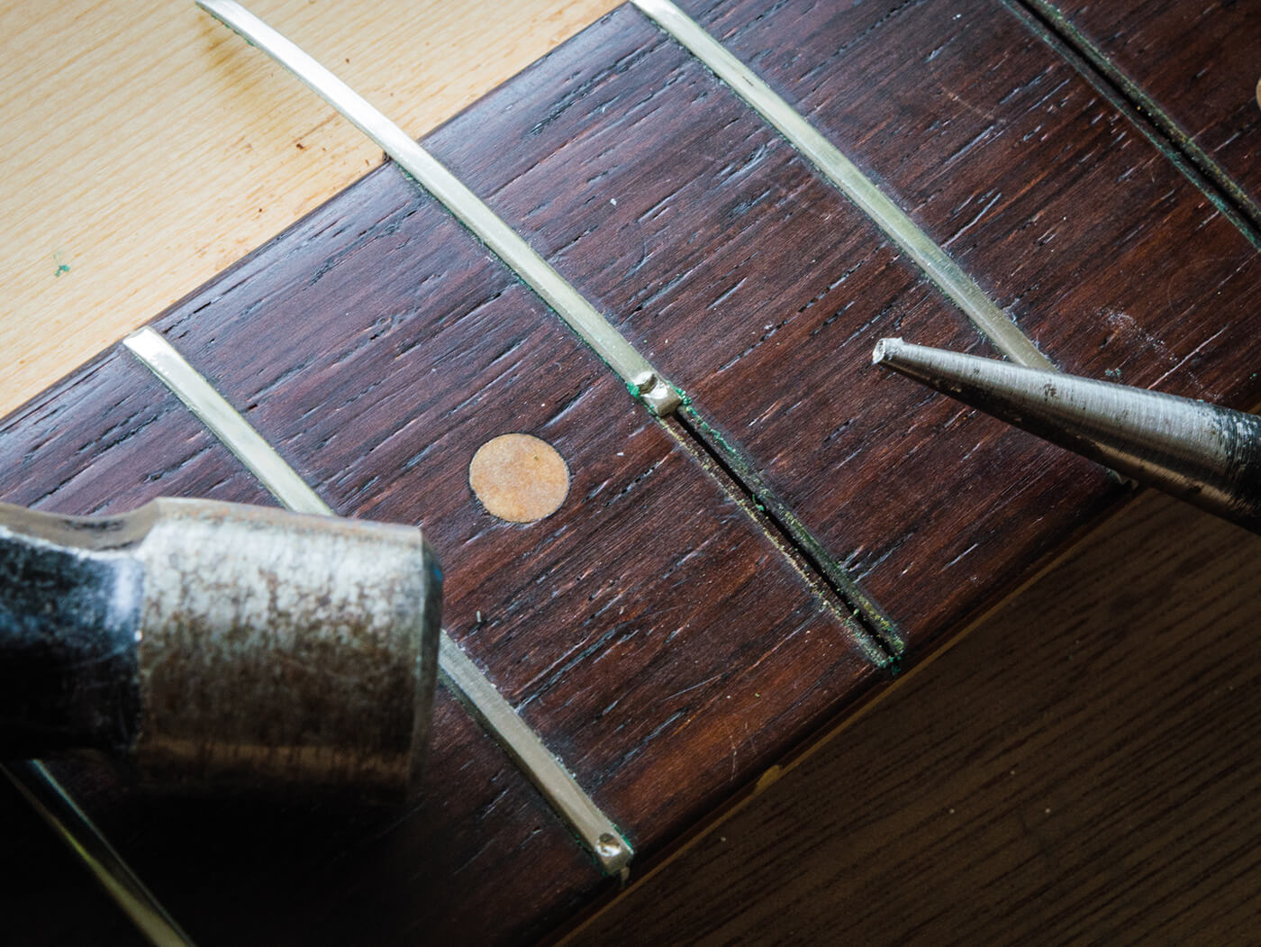 Tapping out frets on strat fingerboard