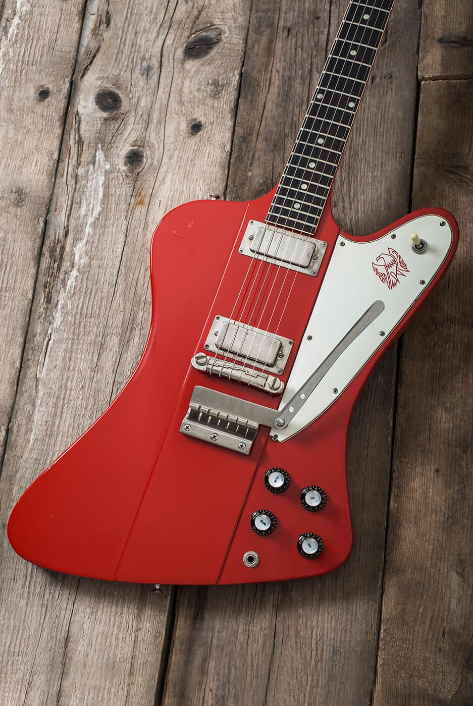 Gibson 1964 Firebird III red portrait on parquet floor