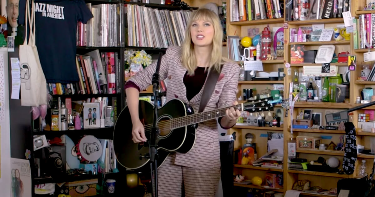 Watch Taylor Swift Slings Her Gibson Acoustic At The Tiny Desk Guitar Com All Things Guitar