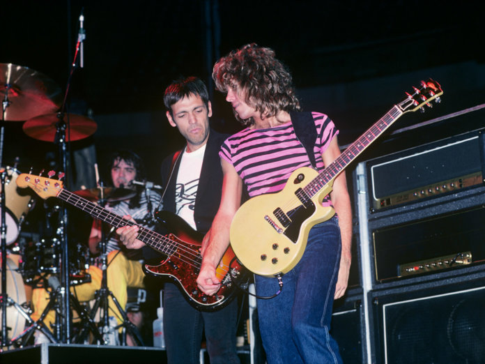 Greg Lubahn (pictured on the left) playing with the Billy Squier Band.