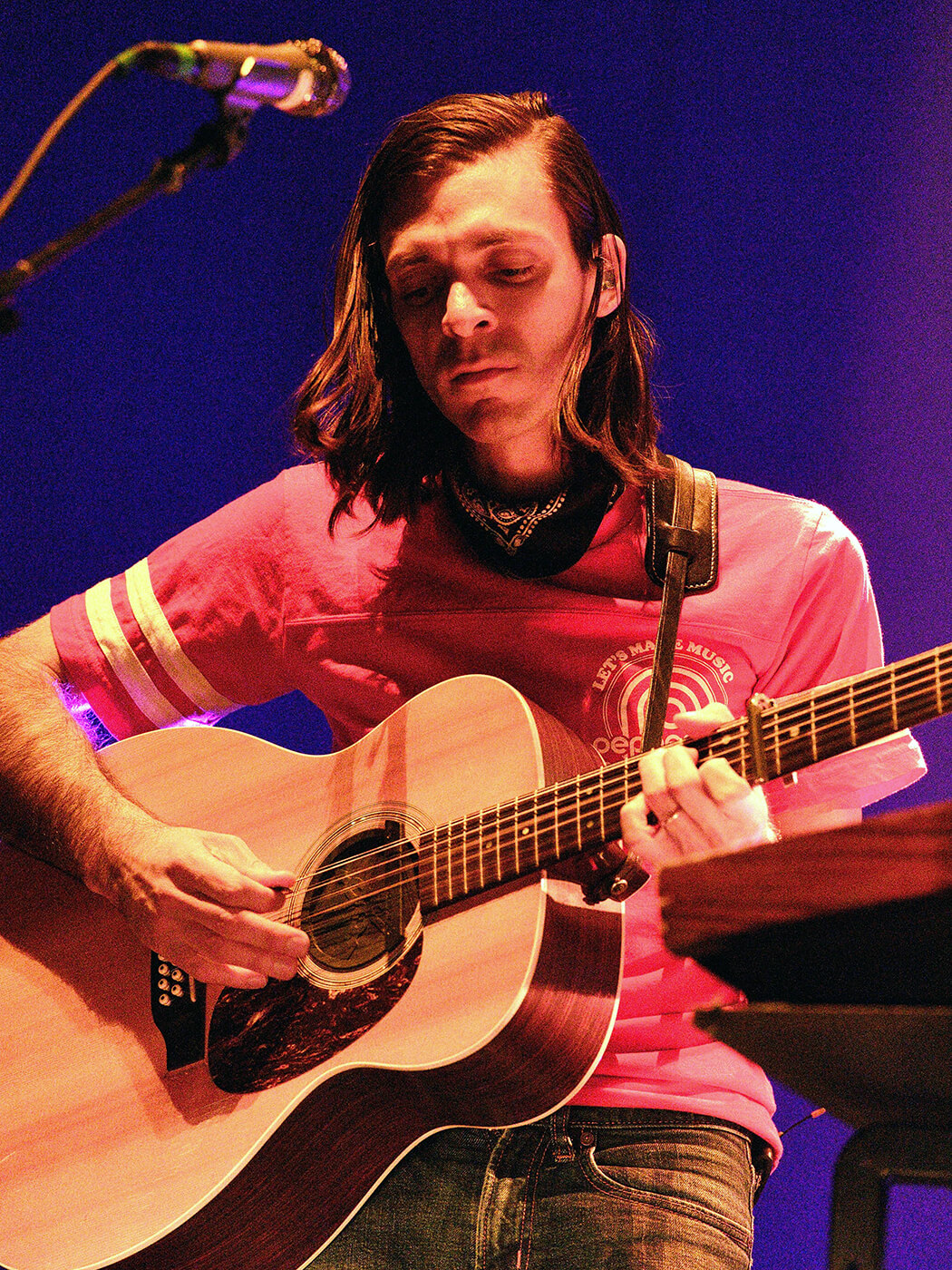 Anthony Lamarca performing with an acoustic guitar.