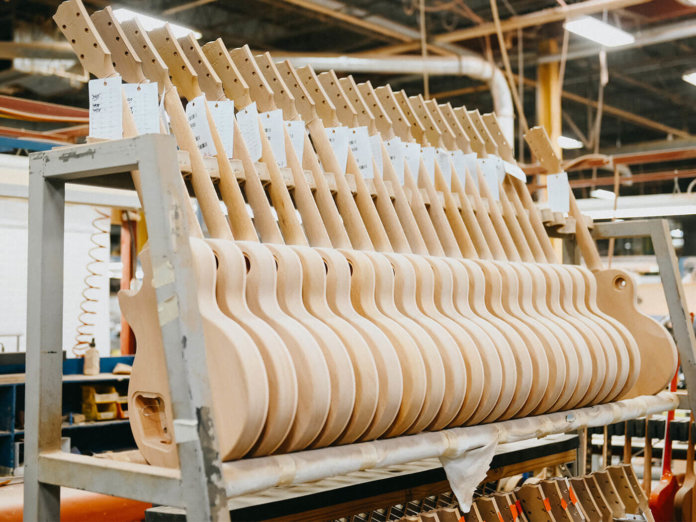 Guitars being manufactured.