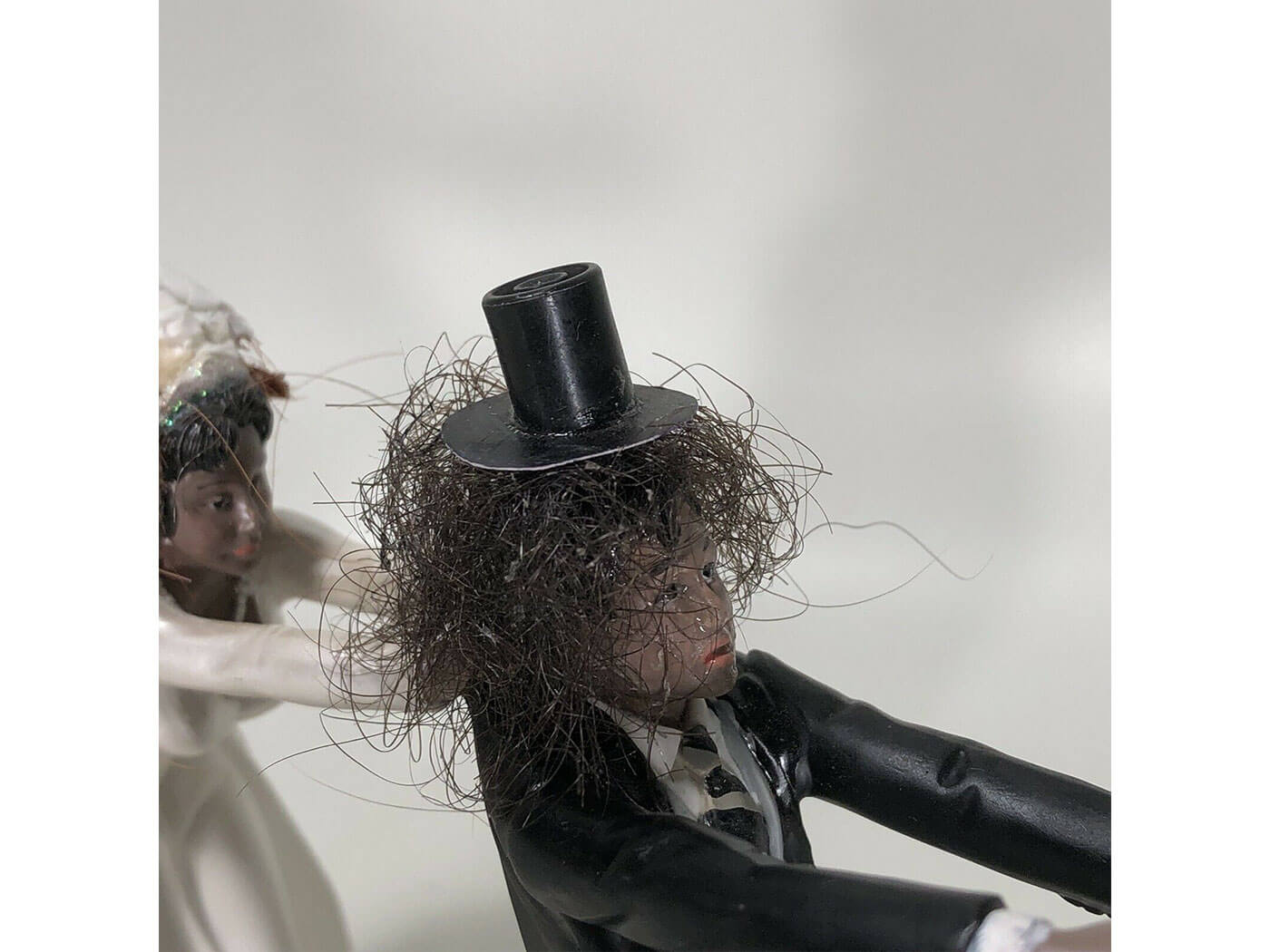 Slash's wedding cake topper, made with human hair.