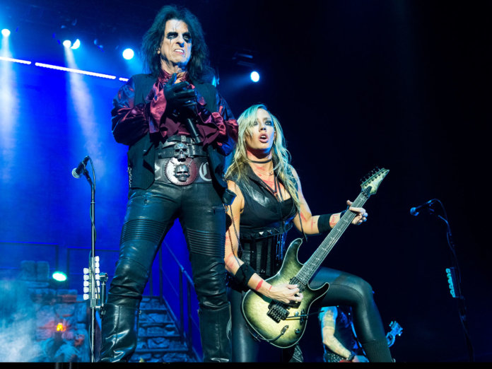 Alice Cooper performing with Nita Strauss