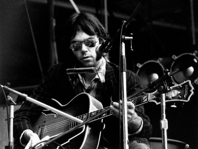 Neil Young onstage in 1974