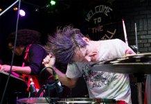 Greg Saunier of Deerhoof onstage
