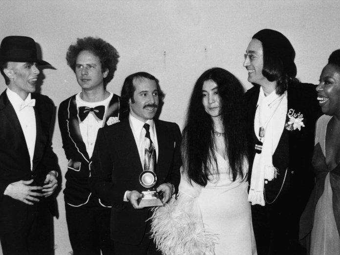 (L-R) David Bowie, Art Garfunkel, Paul Simon, Yoko Ono, John Lennon and Roberta Flack at the 1975 Grammy Awards