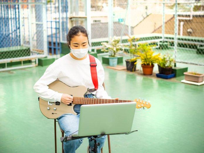 Girl Learning Guitar
