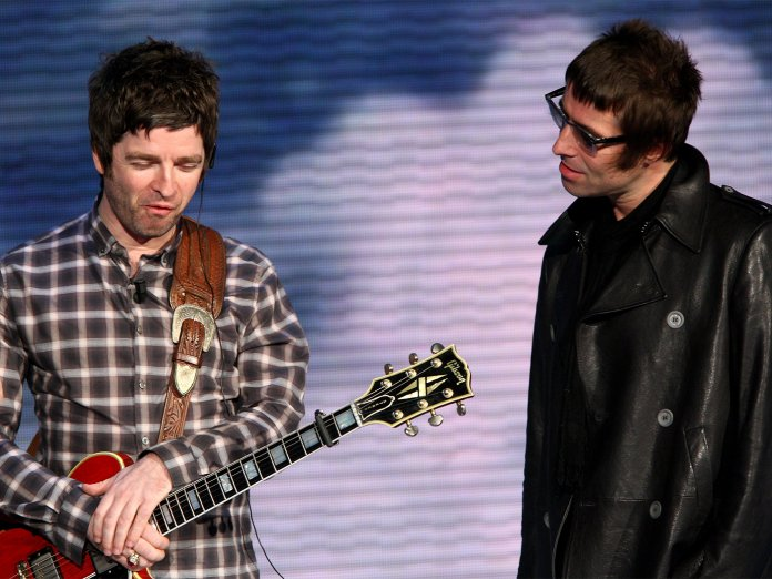 Noel and Liam Gallagher onstage