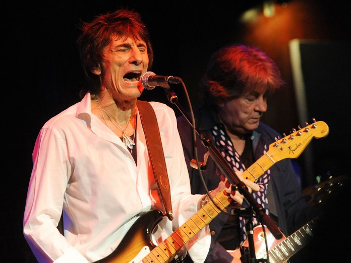 Ronnie Wood with Mick Taylor onstage