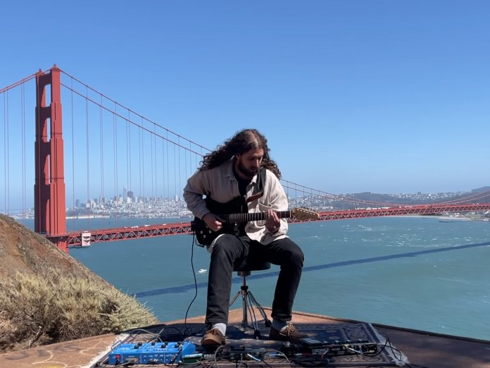 Nate Mercereau performing in front of the Golden Fate Bridge
