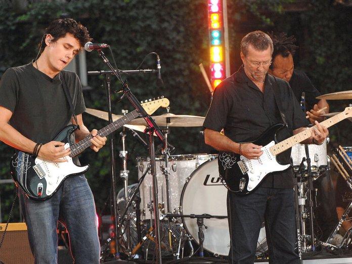 John Mayer and Eric Clapton performing